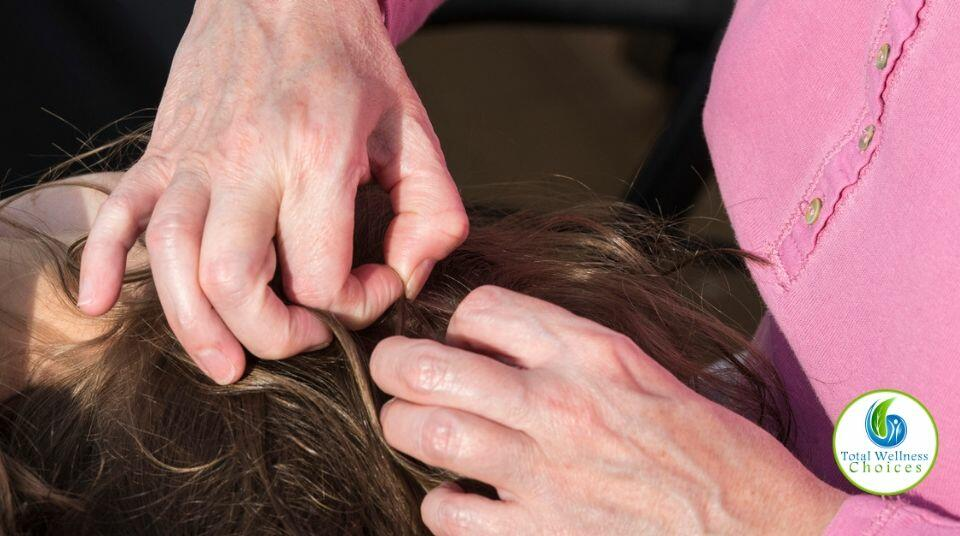 A woman looking for lice in her child's head